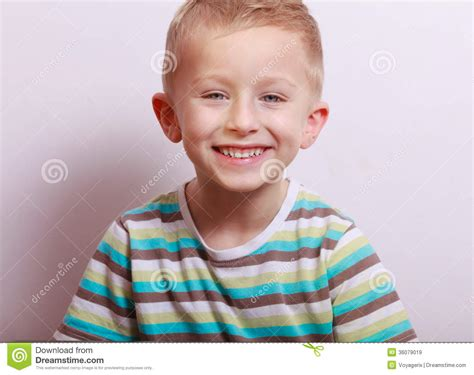 portrait of happy laughing blond boy child kid at the
