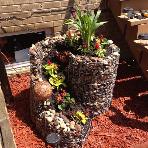 Homemade Flower Pots Ideas | homemade rock flower pot outside gardening ideas and