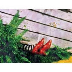 wicked witch shoes under house wizard of oz 17252 wicked witches legs under house 6x8 canvas wall art what s it worth