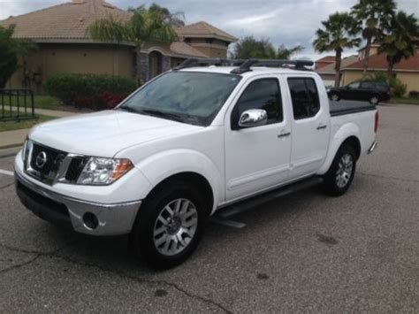 2012 nissan frontier crew cab sl for sale 20 used cars from 16 423 purchase used 2012 nissan frontier sl crew cab pickup 4 door 4 0l in ruskin florida united