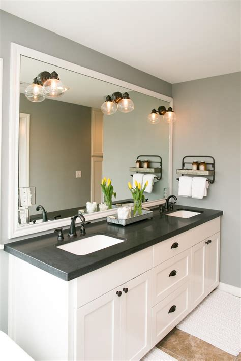 bathroom vanity with her the master bathroom has black granite countertops with