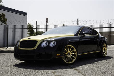 black and gold bentley fort jealous with a set of gold flangiato s