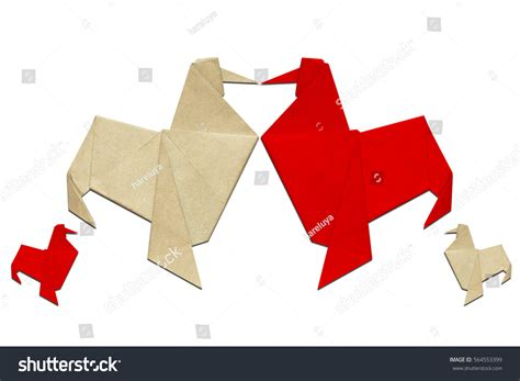 Origami Knot - paper folded rooster handmade origami lucky stock photo