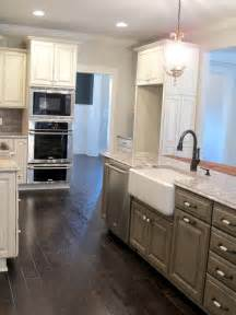 ordinary Do You Tile Under Kitchen Cabinets #3: white-glazed-cabinets-minka-lighting-bianco-antico-granite-subway-tile-backsplash-gray-kitchen-island-kohler-farm-house-sink-distressed-hardwood-floors-luxe-homes-and-design-jefferson-park-knoxville.jpg
