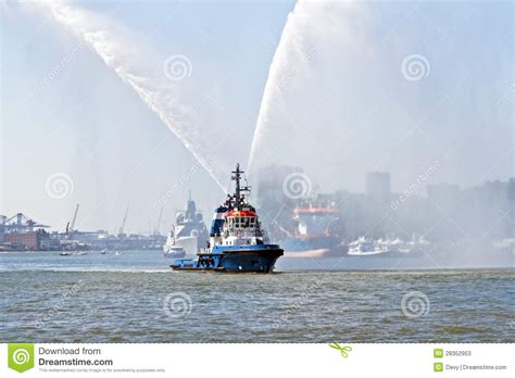 fire boat spraying water blue fire boat spraying water in rotterdam harbor