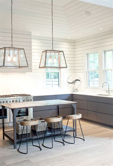 an industrial farm house style kitchen with great lighting