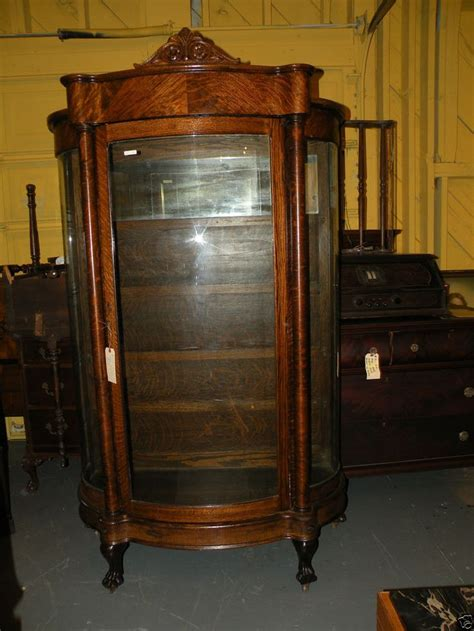 Antique very large oak curved glass china cabinet hutch paw feet