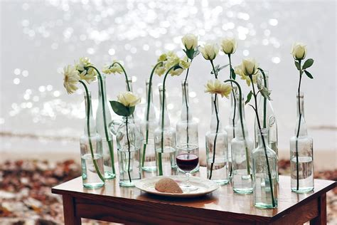vases for wedding reception centerpieces glass bottles serve as vases for wedding reception