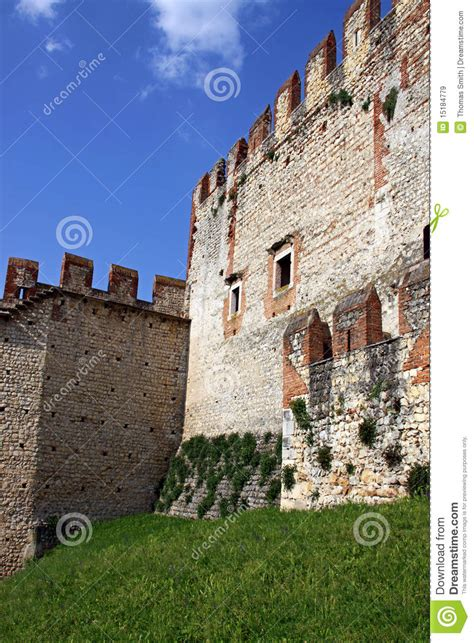 the fortified walls of an italian castle editorial stock