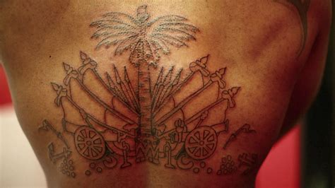 haitian coat of arms tattoo black ink crew video clip