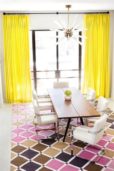 canary yellow curtains gray armless dining bench in front of arch window
