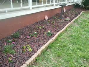 flower beds with rocks flower bed utilizing lava rocks flowers pinterest