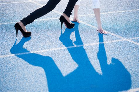 the of running in heels with high heels on the running track concept