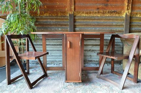 Folding Table With Chairs Stored Inside Drop Leaf Gate Leg Table 4 Folding Chairs Stored Inside The Table Drop Leaf Table And Chairs