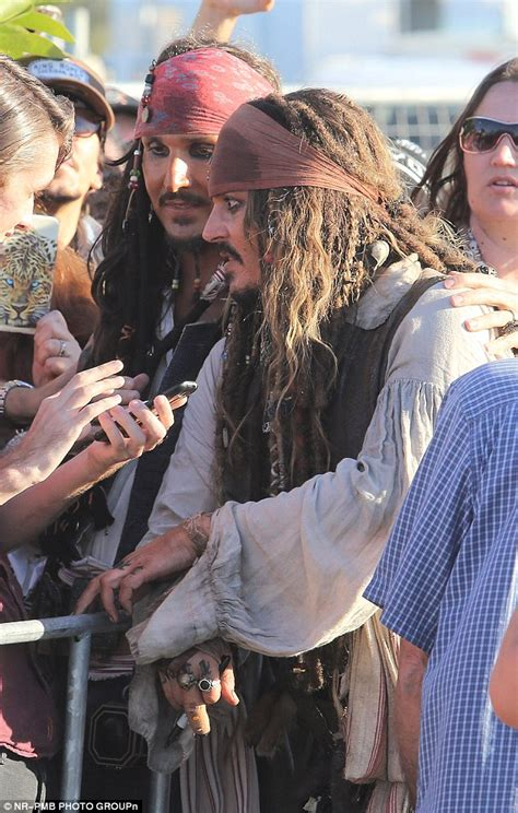 oh captain my captain johnny depp as jack sparrow johnny depp cosies up to female fans as he gushes about