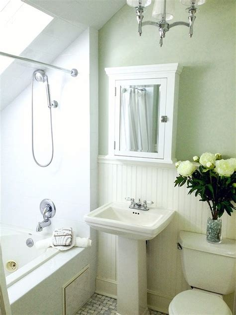 small green and white master bathroom with carrara marble