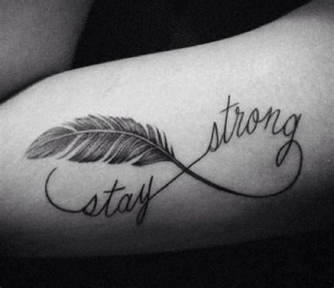 upper arm tattoo saying with pain comes strength on strength tattoo quotes on upper arm combined with infinite