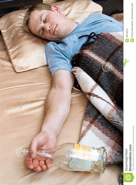 sleeping on the couch young man sleeping on the couch stock photo image 18079270