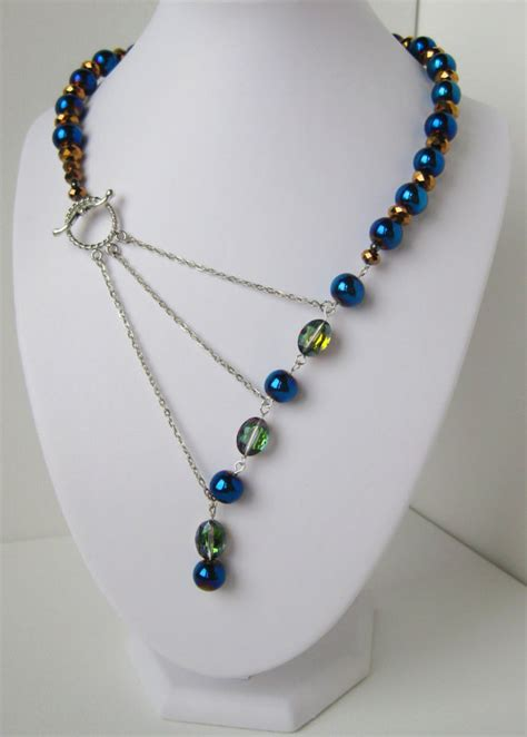 bead jewelry peacock blue green and gold adrienne adelle signature