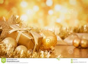 christmas scene gold baubles gift gold background stock photo image 62924505