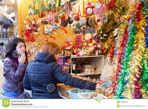 two women choosing christmas gifts editorial stock image