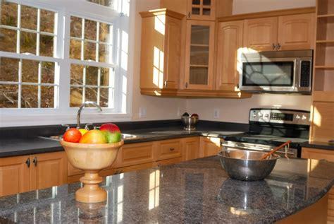 granite countertops with dark wood cabinets granite photos starting at 1999 per sf ronys countertops