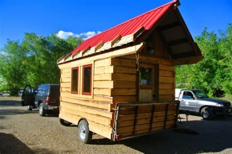 tiny timber homes tiny homes on wheels man builds log cabin tiny house with hinged overhangs