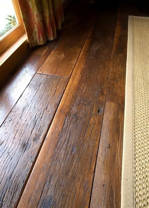 Distressed Rustic Wood Flooring - 25 best ideas about laminate flooring on grey