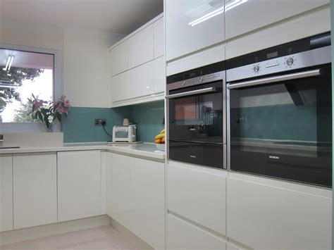 Modular Kitchen Furniture rimini handleless cream glass splashback pebble kitchens