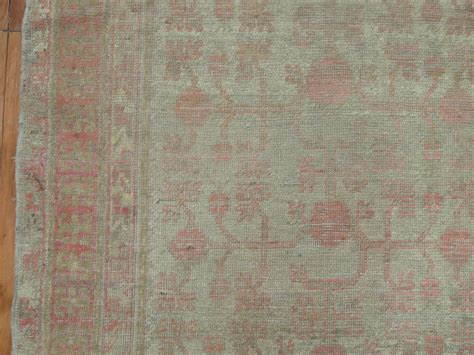 gray and pink east turkestan khotan rug for sale at 1stdibs