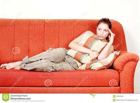 laying couch woman with headache laying on sofa stock photo image