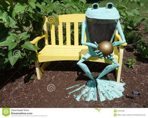 frog on a bench frog bronze statue on yellow bench royalty free stock