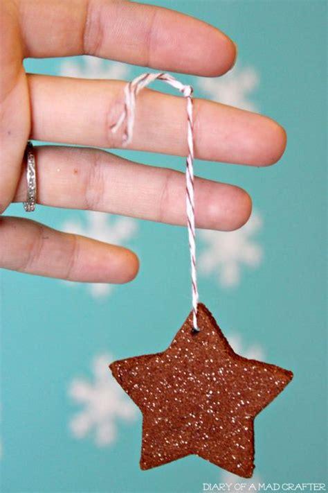 cinnamon dough ornaments orange dough ornaments and cinnamon on