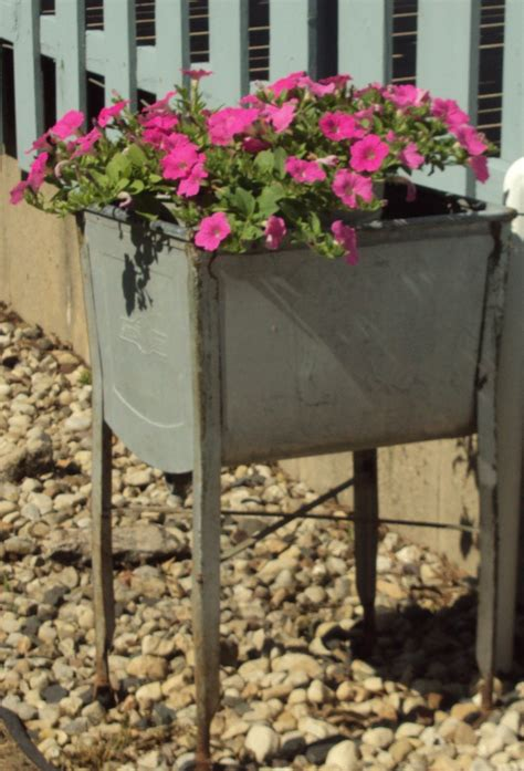 Garden Tubs And Pots Wash Tub With A Flower Pot Inside Garden Decorations