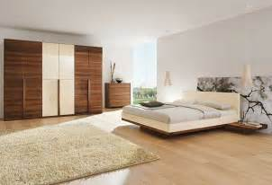 modern decor white bedroom wall with white bed floating on brown wooden