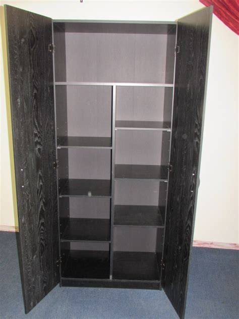 large cupboard with shelves lot detail second large two door cupboard wardrobe with