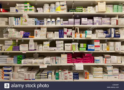 Shelf Drugs pharmaceutical drugs on shelves in a community dispensing chemist stock photo royalty free