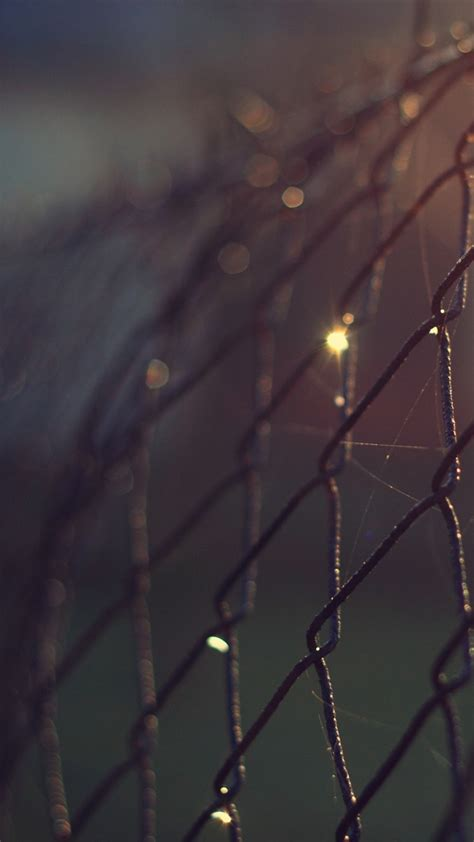 steel cage focus bokeh wallpaper iphone wallpaper iphone