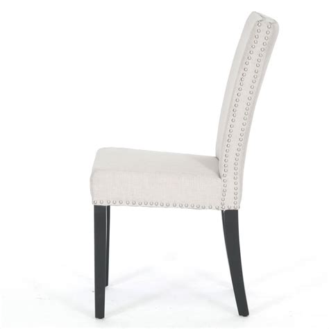 painting of white upholstered dining chair