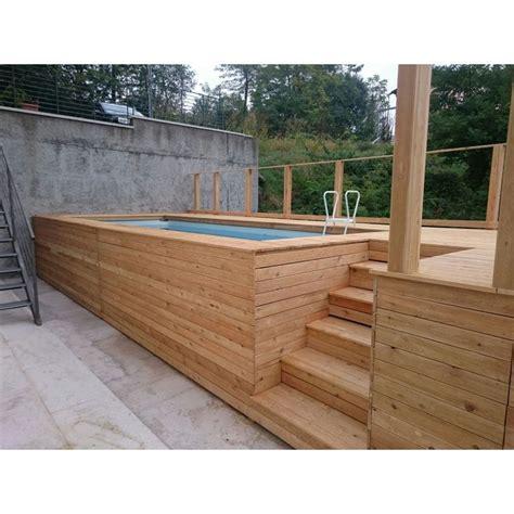 Piscine Fuori Terra Rivestite In Legno piscina fuori terra con solarium rivestita in legno di larice