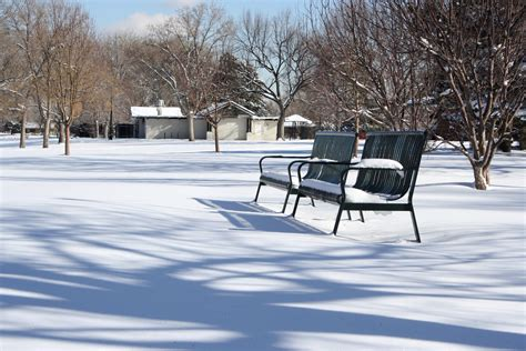 bench in snow park benches in the snow picture free photograph