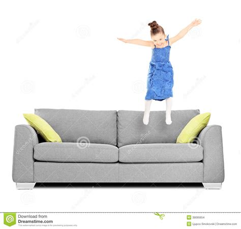 happy kid jumping on stock photo image
