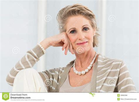 elegant mature woman wearing silver jewelry stock photo relaxed mature woman stock photo image 39865386
