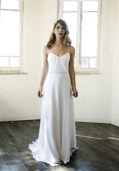 White chiffon blouson dress with pleats on top and chapel