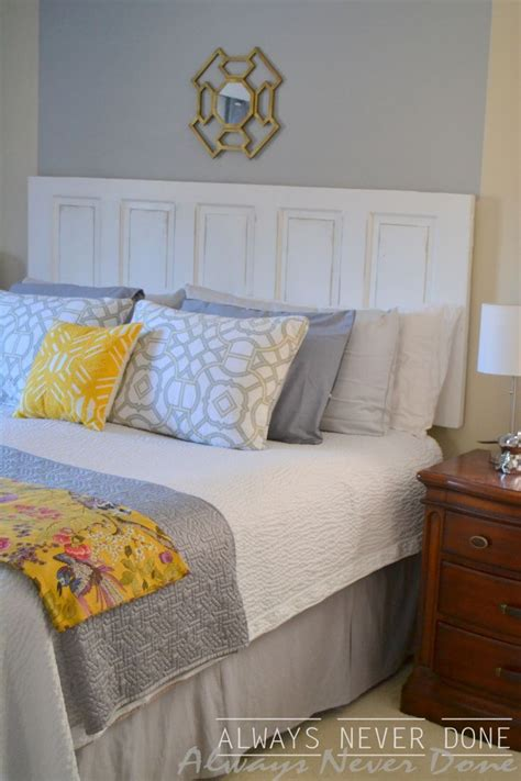 how to make and hang a headboard out of an door and