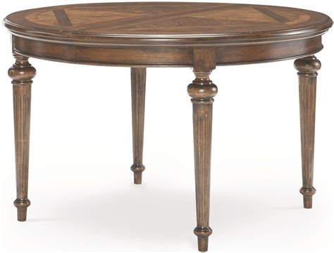 brown round extendable dining table latham tawny brown extendable round dining table from