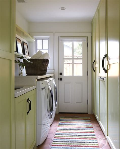 yellow laundry yellow laundry room cabinets cottage laundry room