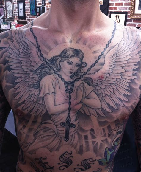 angel tattoo chest piece 99 breathtaking angel tattoos with meaning tattoo