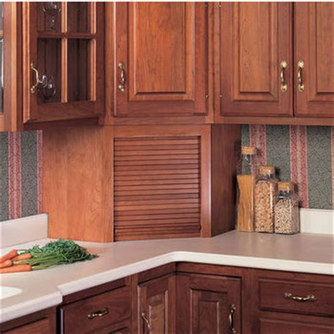 kitchen cabinet garage door omega national tambour corner wood kitchen appliance garage