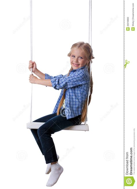 sitting on a swing happy blonde girl sitting on swing stock photo image